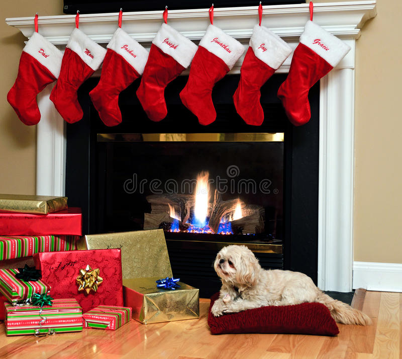 Christmas stockings by the fireplace stock photos