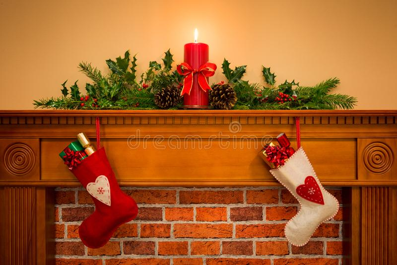Christmas stockings hanging on the fireplace stock image