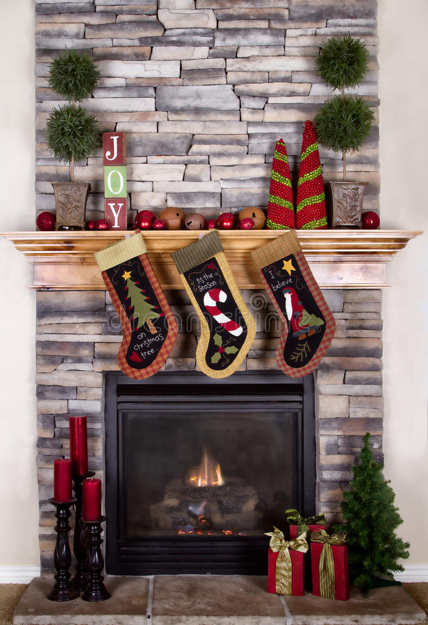 Free Christmas Stockings Hanging From Fireplace Stock Photography - 26292532