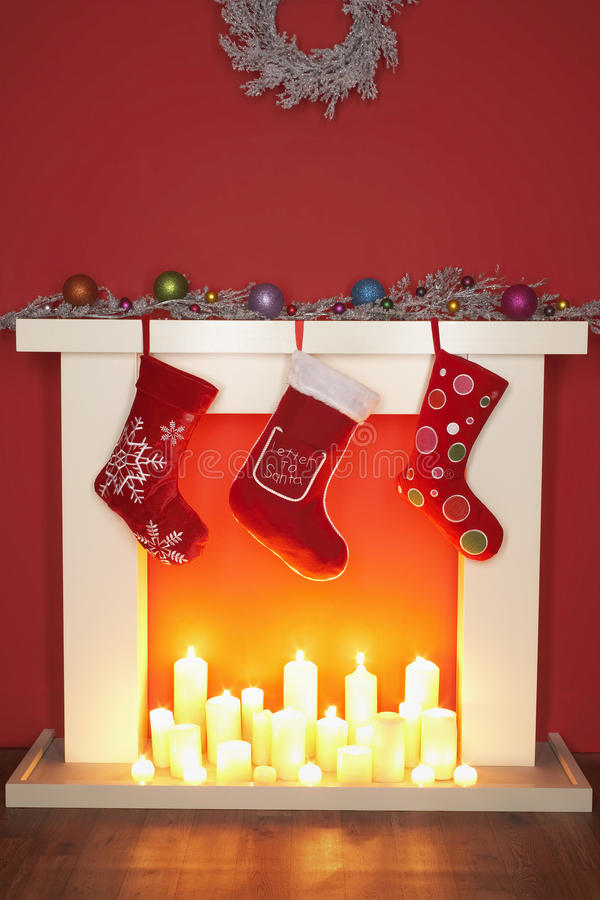 Christmas stockings hanging over fireplace royalty free stock photos