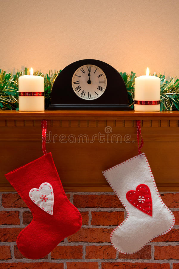 Christmas stockings on the mantlepiece stock photo