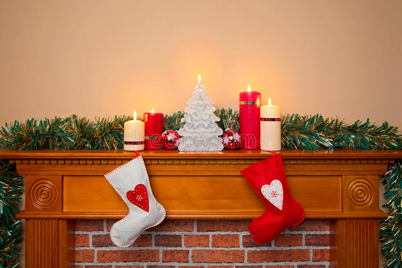 Christmas stockings over a fireplace stock photos