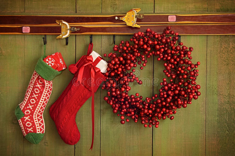 Download Christmas Stockings And Wreath Hanging On  Wall Stock Photo - Image: 21791402