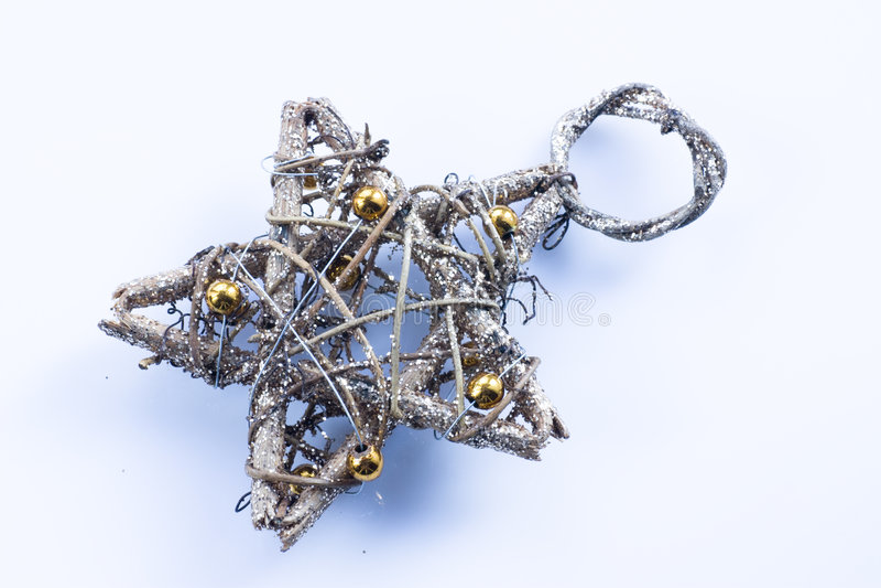Christmas straw star. On white stock image