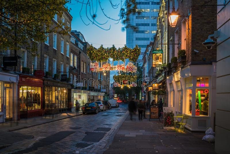 Christmas street decorations at Seven Dials in London, UK stock photography