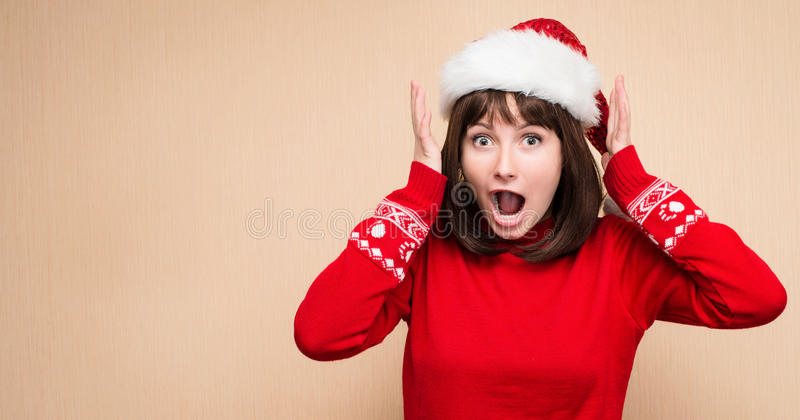 Christmas stress - woman wearing santa hat stressing for christmas shopping with copyspace for your text. Funny image of shouting stock photo