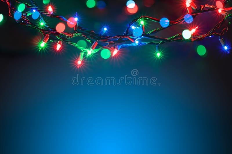 Christmas lights over black background royalty free stock photography
