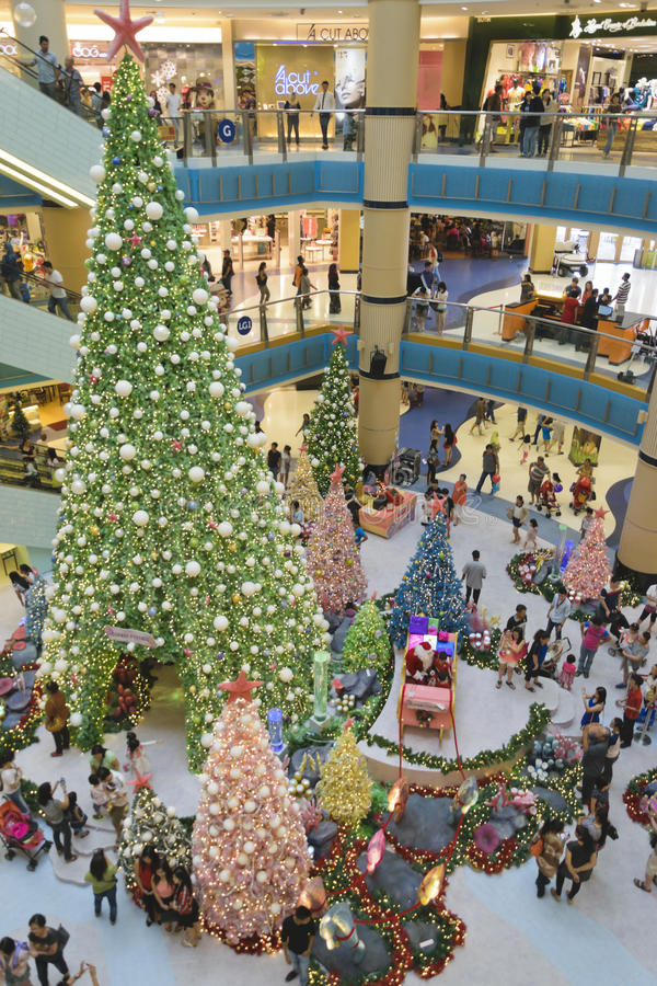 Christmas at Sunway Pyramid Shopping Center. A grand Christmas Tree with busy and happy shoppers at Sunway Pyramid Shopping mall stock image