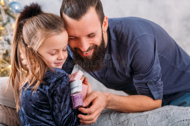 Christmas surprise family girl happy gifts daddy royalty free stock images
