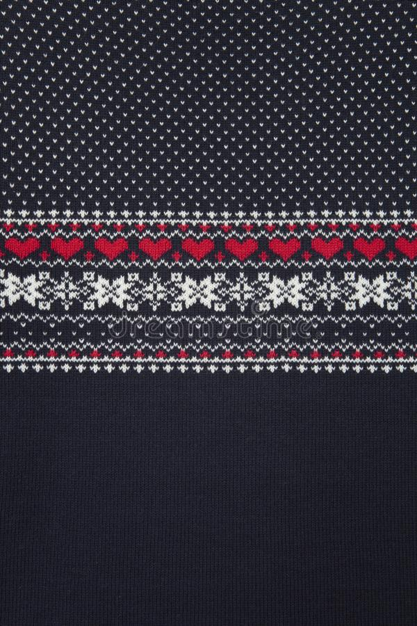 Christmas sweater knitting patterns. Knitted texture. stock images