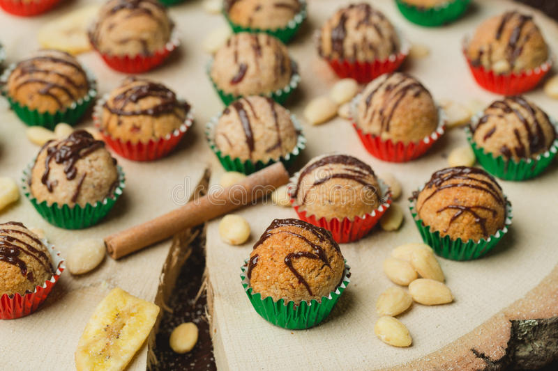 Christmas sweet balls. Sweet balls on wooden table royalty free stock photography