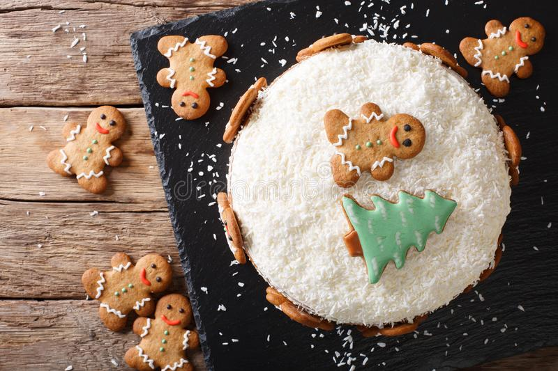 Christmas sweet cake with cheese cream and gingerbread close-up. horizontal top view royalty free stock images