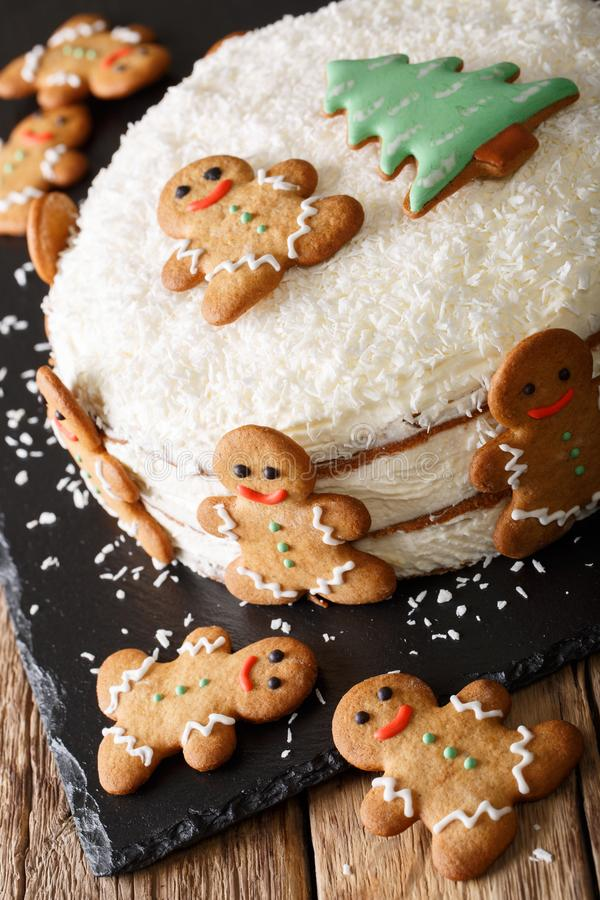 Christmas sweet cake with cheese cream and gingerbread close-up. vertical royalty free stock images