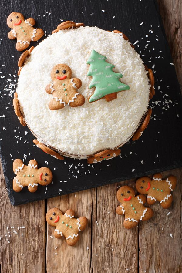 Christmas sweet cake with cheese cream and gingerbread close-up. Vertical top view stock image
