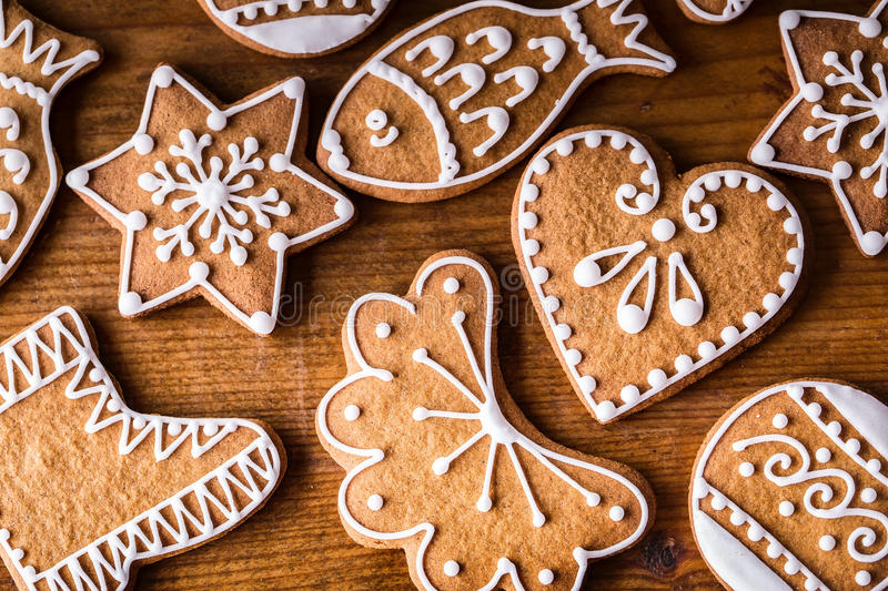 Christmas sweet cakes. Christmas homemade gingerbread cookies on wooden table.  royalty free stock photos