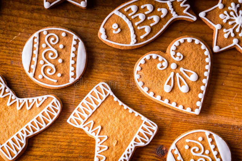 Christmas sweet cakes. Christmas homemade gingerbread cookies on wooden table.  royalty free stock image