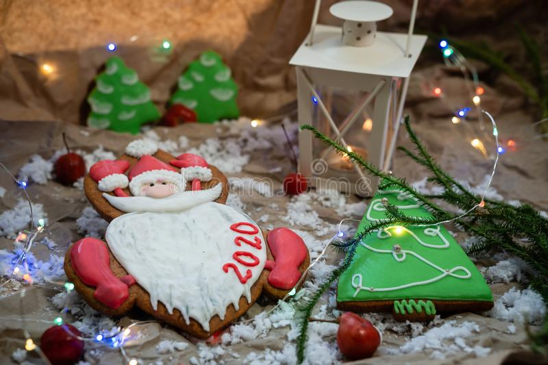 Christmas sweets on dark paper with a lamp and a garland to eat Gingerbread stock photos