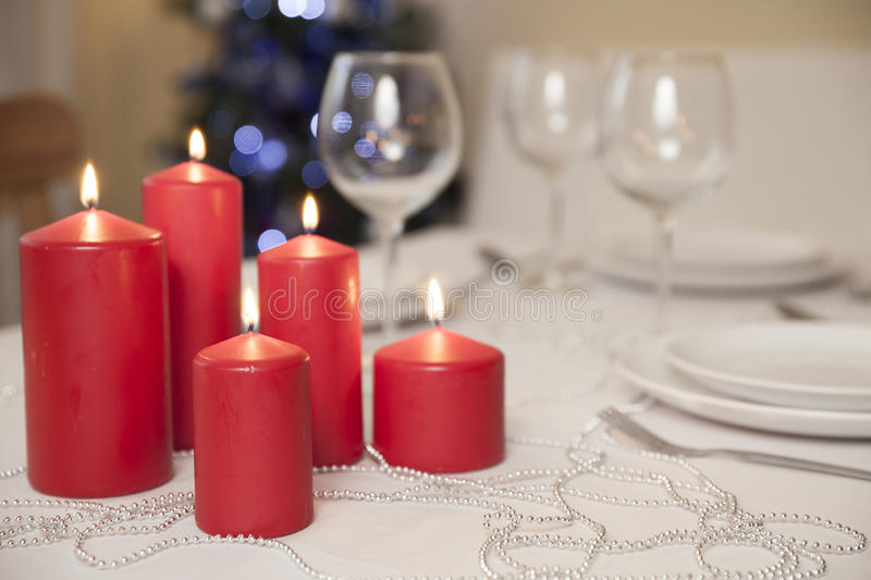 Christmas table with candles at home royalty free stock photography