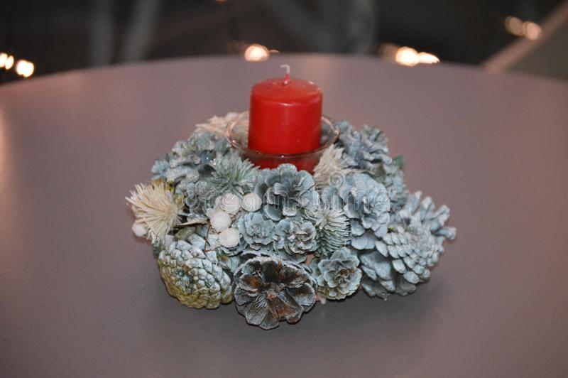 Christmas Centerpiece Red Pillar Candle Holiday Decoration Pine Cones royalty free stock images