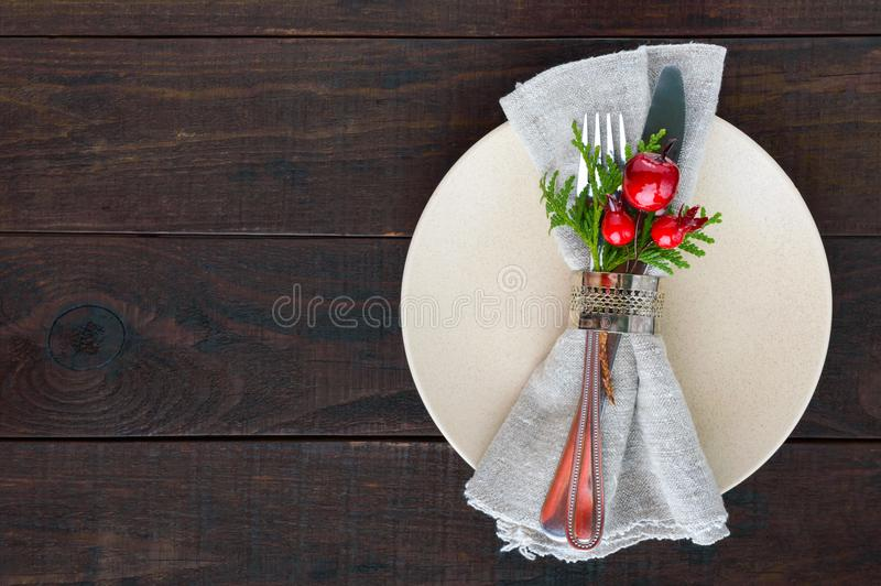 Christmas table decoration. Christmas dinner plate, cutlery decorated festive decorations. royalty free stock photography
