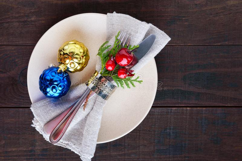 Christmas table decoration. Christmas dinner plate, cutlery decorated festive decorations. royalty free stock photo