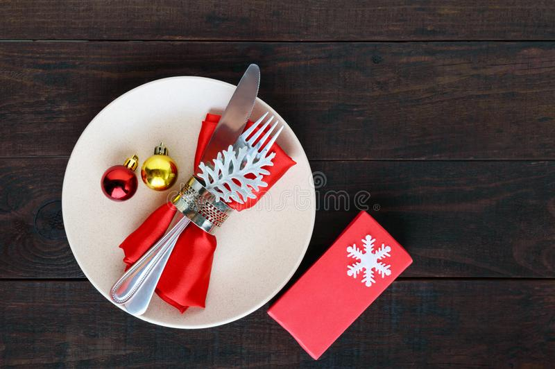 Christmas table decoration. Christmas dinner plate, cutlery decorated festive decorations. stock photo