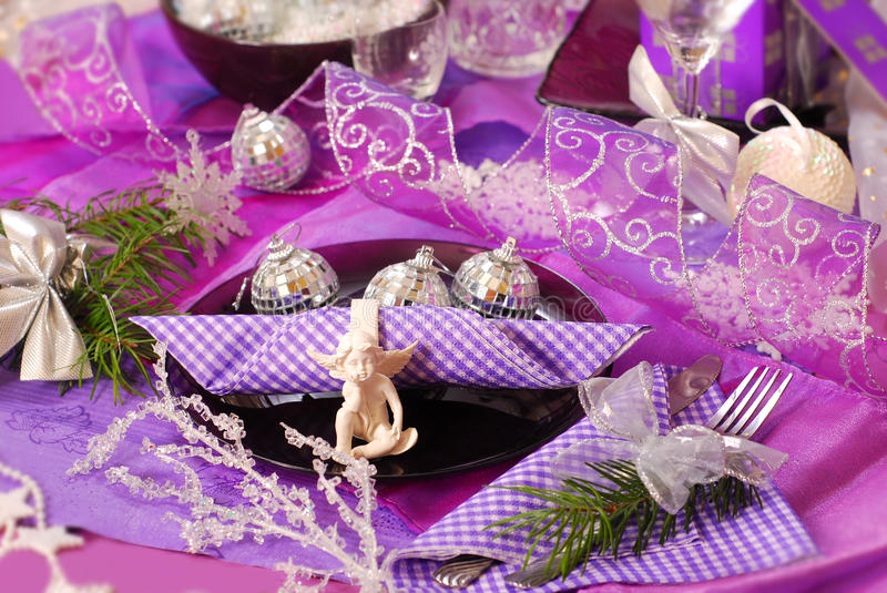 Christmas table decoration in purple color stock images