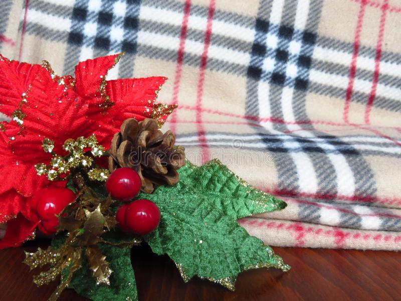 Christmas table decoration on warm winter blanket background. New year decoration. stock photo