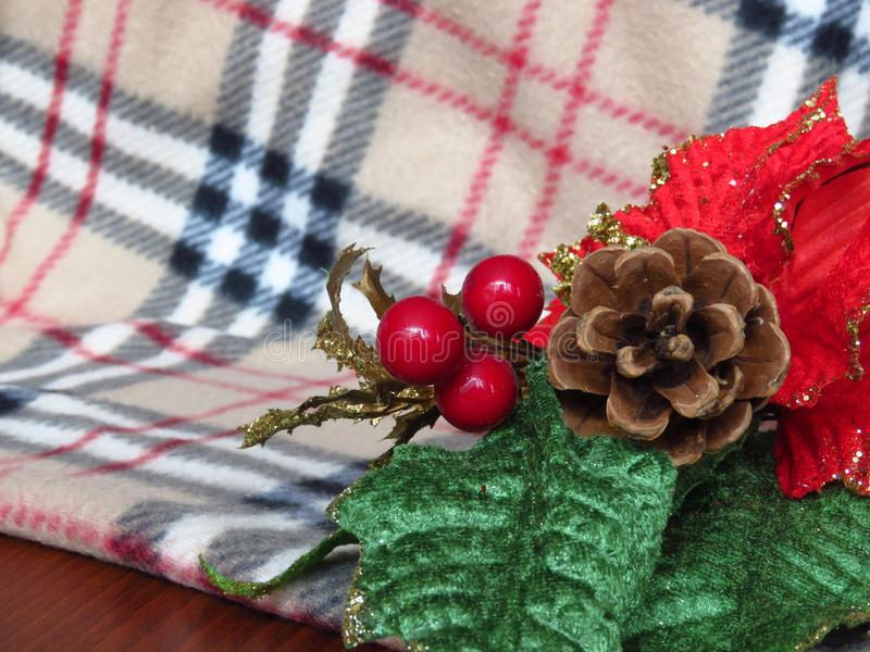 Christmas table decoration on warm winter blanket background. New year decoration. royalty free stock photo