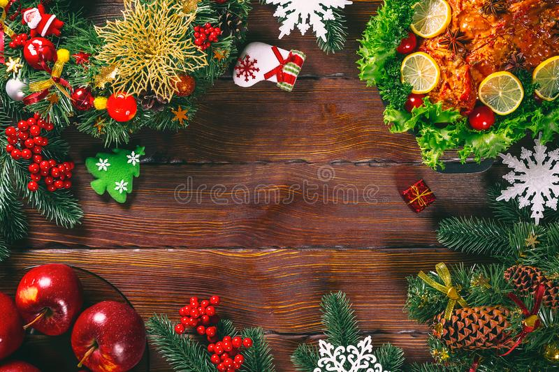 Christmas table dinner time with roasted meats decorated in Christmas style. Background thanksgiving. The concept of a family holi royalty free stock images