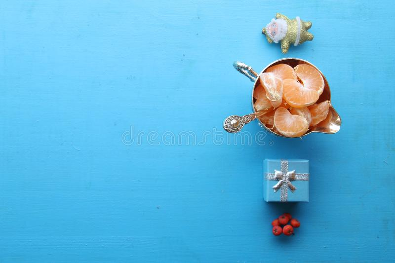 Christmas table. Holidays background. Objects on blue table royalty free stock photo