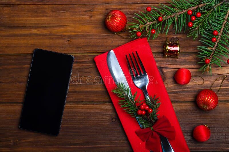 Christmas table: knife and fork, plate, napkin, christmas tree b stock photos