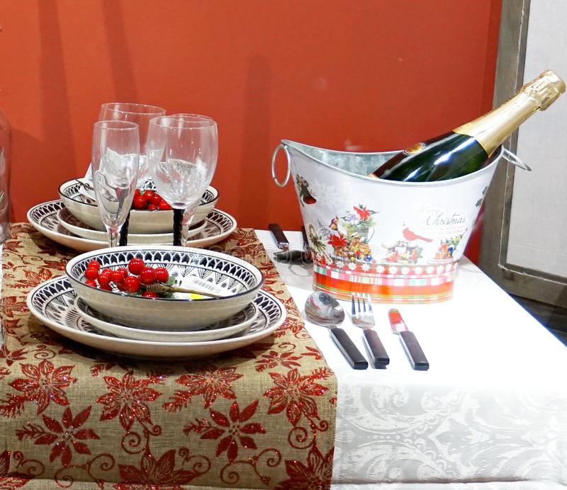 Christmas table with mistletoe, happiness and champagne royalty free stock photography
