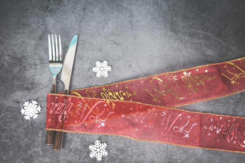 Christmas table place setting decoration with fork knife Xmas New Year food lunch festive Christmas dinner holidays background royalty free stock photos