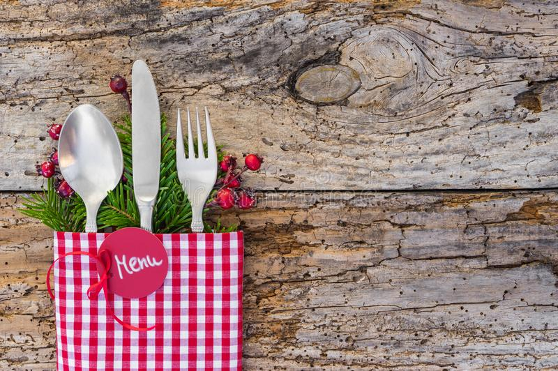 Christmas table place setting, rustic wooden background, copy space stock photo