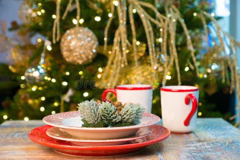 Christmas table preparation near xmas tree royalty free stock image