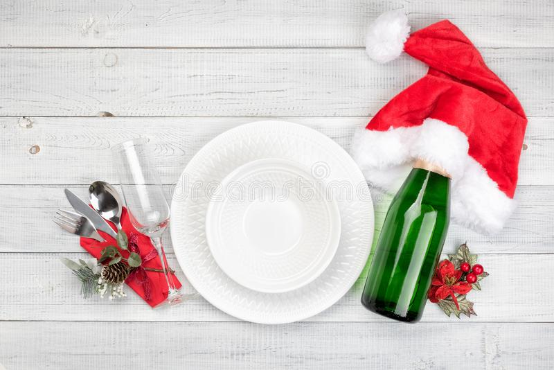 Christmas table setting with a bottle of champagne stock photos
