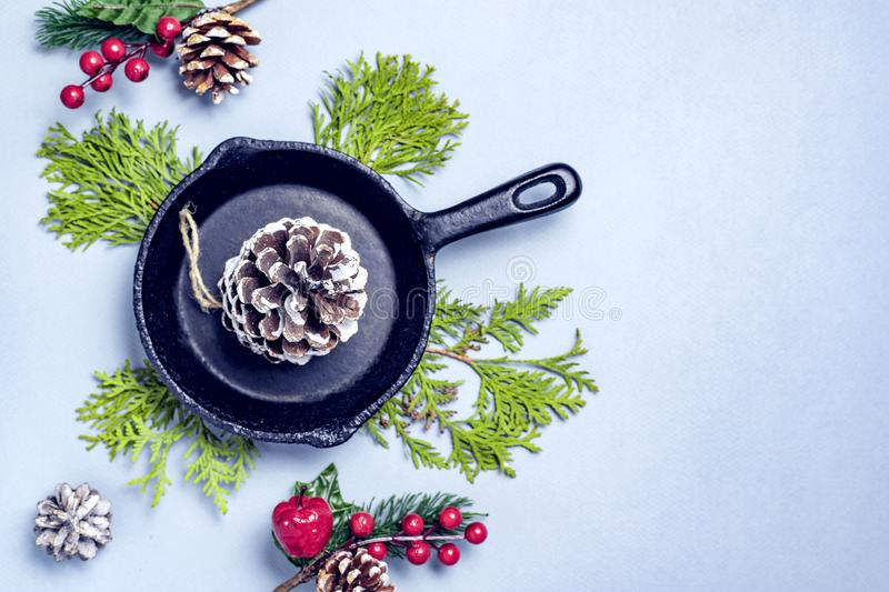 Christmas table setting with empty iron pan with cone and thuja branches . Winter holidays and festive background. Christmas eve. Dinner, New Year food lunch royalty free stock photos