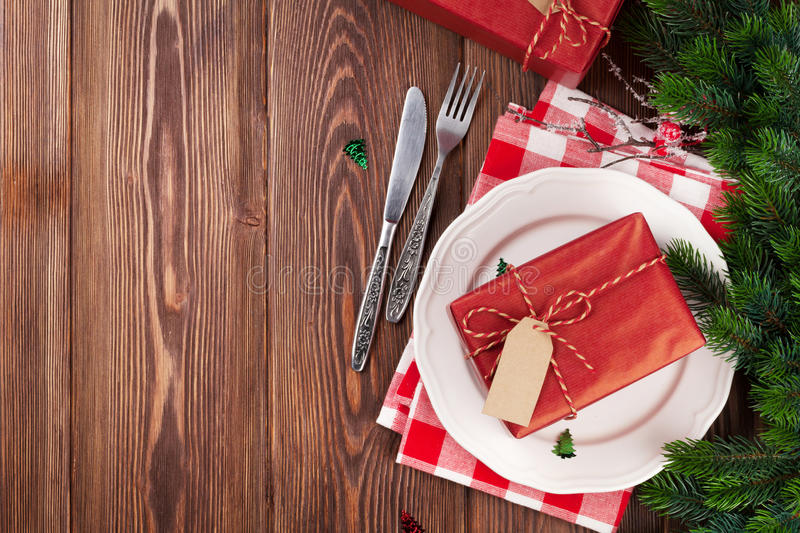 Christmas table setting with gift box and fir tree royalty free stock images