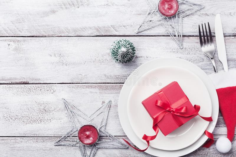 Download Christmas Table Setting. Gift Box Fir Tree White Plate And Silverware On  sc 1 st  Dreamstime.com & Christmas Table Setting. Gift Box Fir Tree White Plate And ...