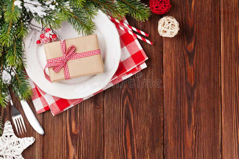 Christmas table setting with gift box and fir tree royalty free stock image