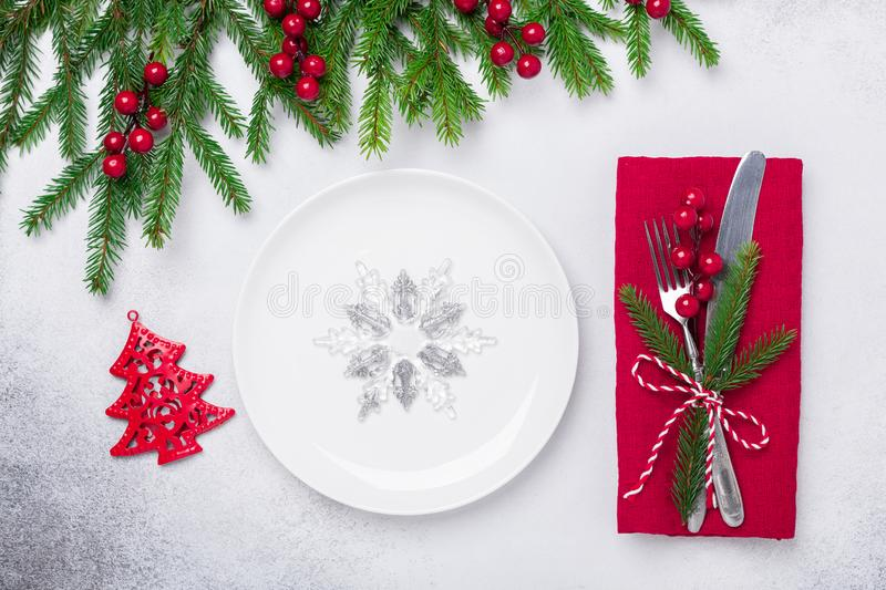 Christmas table setting with gifts and fir tree branch on stone background. Top view. Copy space royalty free stock photo