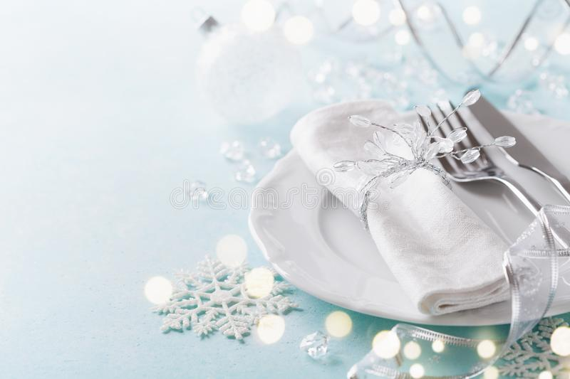 Christmas table setting for holiday dinner. Bokeh effect. Empty space for menu. Christmas table setting for holiday dinner. Bokeh effect. Copy space for menu royalty free stock images