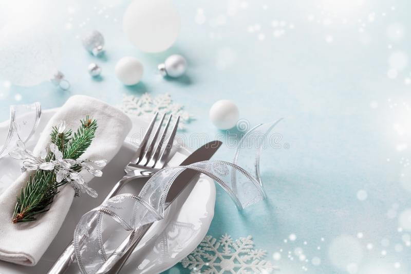 Christmas table setting for holiday dinner. Bokeh effect. Empty space for menu. Christmas table setting for holiday dinner. Bokeh effect. Copy space for menu stock images