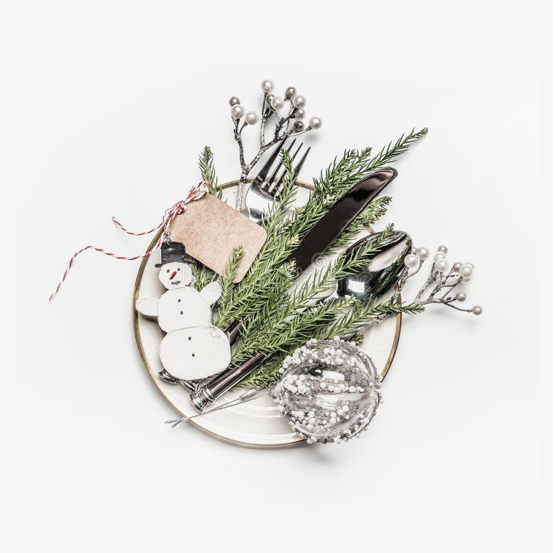 Christmas table setting . Plate with fir branches , cutlery and festive holiday decoration royalty free stock images
