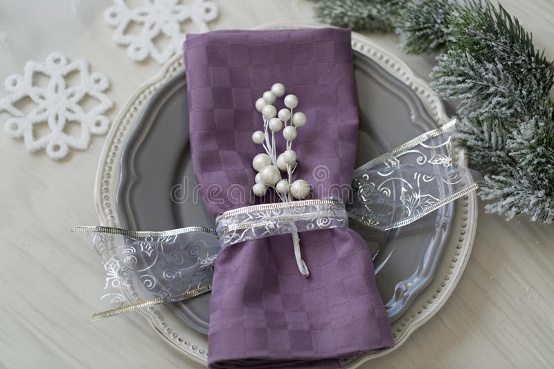 Christmas table setting in silver tone stock images