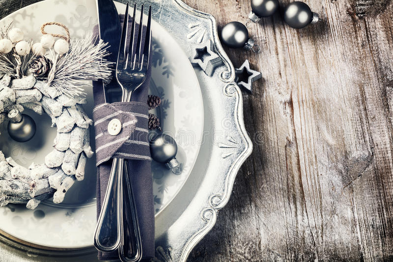 Christmas table setting in silver tone stock image