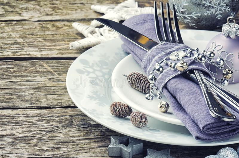 Christmas table setting in silver tone stock photo