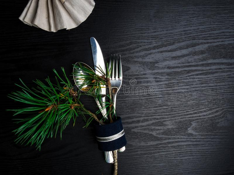 Christmas table setting in silver tone on wooden table royalty free stock photos