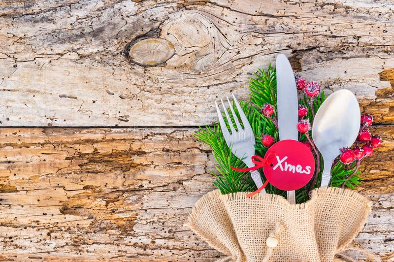 Rustic silverware for Christmas dinner, with tag xmas, and empty space for text on wood stock images